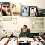 "Abdul Sattar Edhi sits at his desk in the Mithadar district of Karachi. His office is in the same building where, in 1951, he opened his first free pharmacy, and he remains personally on call: ""I am always available to all,"" he says.  Edhi may be the most widely admired man in Pakistan, yet he remains little known abroad: Starting in 1951 with a free pharmacy in a poor neighborhood of Karachi, Abdul Sattar Edhi has inspired-by deeds more than words-the growth of a vast nationwide Charitable organization of ambulances, clinics, orphanages, asylums, shelters, mortuaries, hospitals, schools and kitchens staffed today by more than 7000 volunteers and funded entirely by private donations. August 2004."